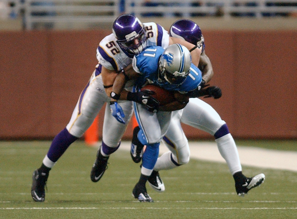 . Detroit Lions wide receiver Stefan Logan, foreground, runs for yardage as he is tackled by Minnesota Vikings linebacker Chad Greenway during first quarter action.  Photo taken on Sunday, January 2, 2010, in a game played at Ford Field in Detroit, Mich.  (The Oakland Press/Jose Juarez)