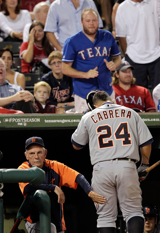 . After striking out in the sixth inning, the Detroit Tigers\' Miguel Cabrera passes manager Jim Leyland as Cabrera enters the dugout at Game 6 of baseball\'s American League championship series against the Texas Rangers, Saturday, Oct. 15, 2011, in Arlington, Texas. (AP Photo/Charlie Riedel)