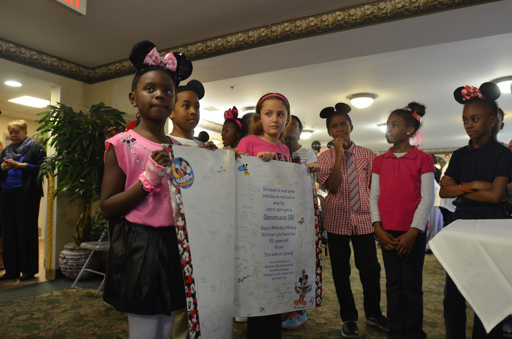 . Kids from Stevenson Elementary School Southfield present a birthday card to Mickey Mouse at the 85th birthday anniversary party organized by Disney On Ice.