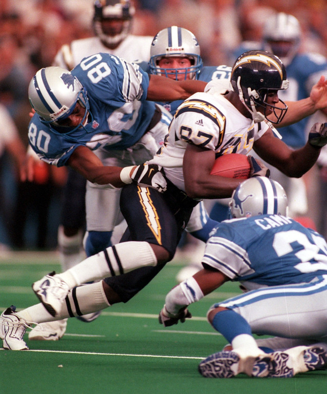 . San Diego Chargers wide receiver Chris Penn (middle, #87) runs for yardage after the catch as he is tackled by Detroit Lions defenders Iheanyi Uwaezuoke (left,#80) and Lamar Campbell (#39) during second half action, Sunday, October 10, 1999.