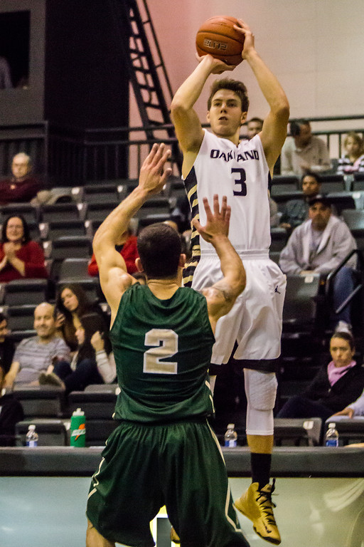 . Oakland\'s Travis Bader attempts a 3-point shot in the first half Tuesday, Oct. 29, 2013 at the Athletics Center O\'rena. Photo by Dylan Dulberg