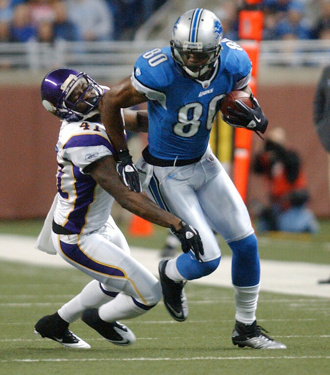 . Detroit Lions wide receiver Bryant Johnson, foreground, runs for yardage as he is tackled by Minnesota Vikings cornerback Frank Walker during first quarter action.  Photo taken on Sunday, January 2, 2010, in a game played at Ford Field in Detroit, Mich.  (The Oakland Press/Jose Juarez)