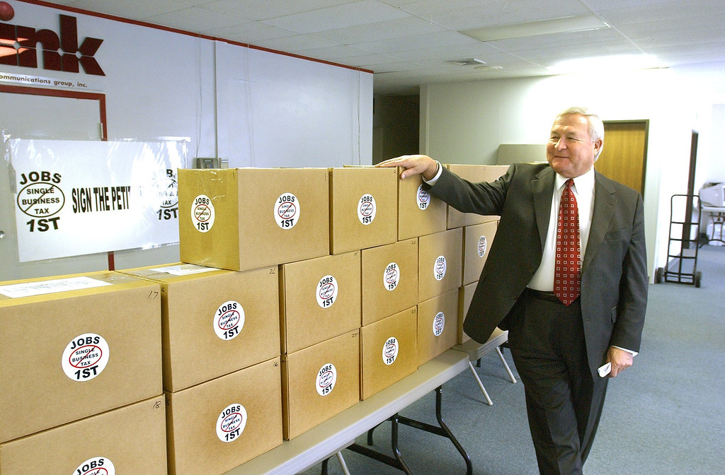 . Oakland County Executive L. Brooks Patterson getting ready to deliver 28 boxes containing 372,604 petitions to repeal the Single Business Tax.  The Oakland Press/TIM THOMPSON