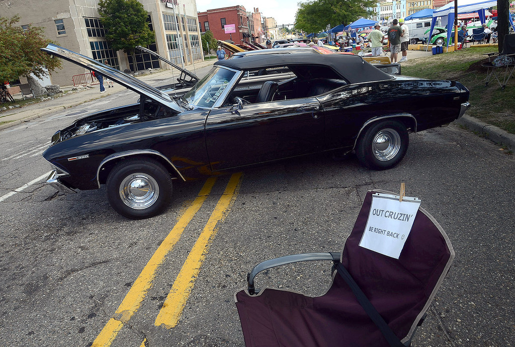 . A cruiser lets people know he\'ll be back to his spot in downtown Pontiac during the 2013 Woodward Dream Cruise, Saturday August 17, 2013. (Oakland Press Photo:Vaughn Gurganian)