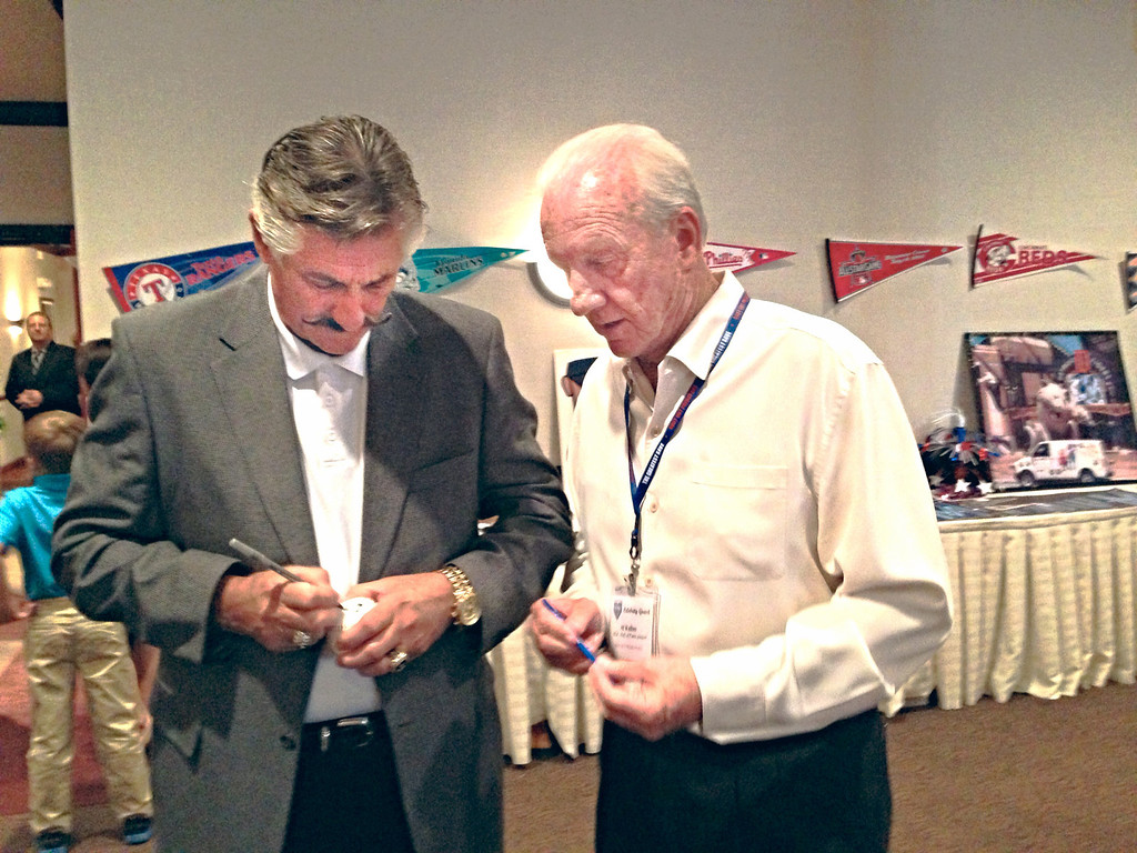 . Major League Baseball Hall of Famers Rollie Fingers (left) and Al Kaline signed baseballs by their still-loyal fans at a fundraiser in Commerce Township for the Greatest Save, a nonprofit which helps protect youth from predators.  The Oakland Press/MONICA DRAKE