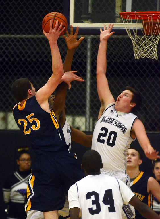 . Clarkston\'s #25 Michael Nicholson goes up for a shot as Bloomfield Hill #20 Logan McDonald goes for a block during their game at Bloomfield Hills High School, Tuesday January 28, 2014. Bloomfield Hills went on to win the game 74-62. (Vaughn Gurganian-The Oakland Press)