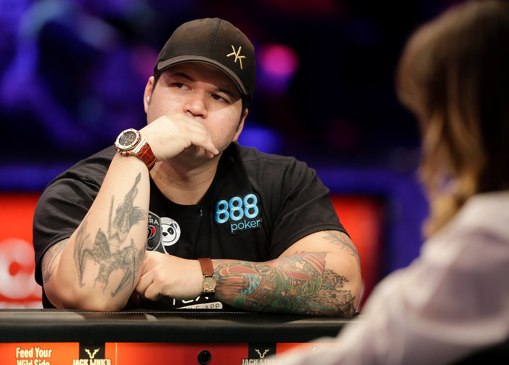 . Jay Farber waits for the next hand after folding against Ryan Riess during the World Series of Poker Final Table, Tuesday, Nov. 5, 2013, in Las Vegas. Riess defeated Farber to win the $8.4 million payout. (AP Photo/Julie Jacobson)