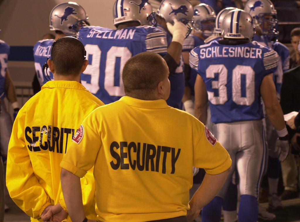 . Security officers watch as the Detroit Lions players take to the field during Monday night\'s game against the St. Louis Rams played at the Pontiac Silverdome in Pontiac, Mich., Monday, October 8, 2001.
