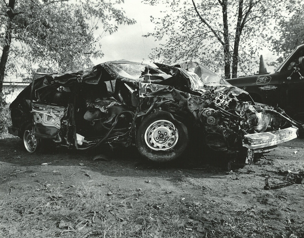 . A junkyard photo taken Oct. 20, 1988 shows the wreckage from the accident involving former Lions player Reggie Rogers that killed three teens in Pontiac. Oakland Press file photo