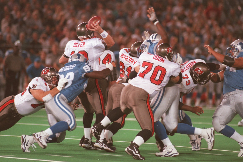. Kerwin Waldroup (93) of the Detroit Lions pulls down Tampa quaterback Trent Dilfer in the first half during Monday nights game against the Tampa Buccaneers at the Pontiac Silverdome.