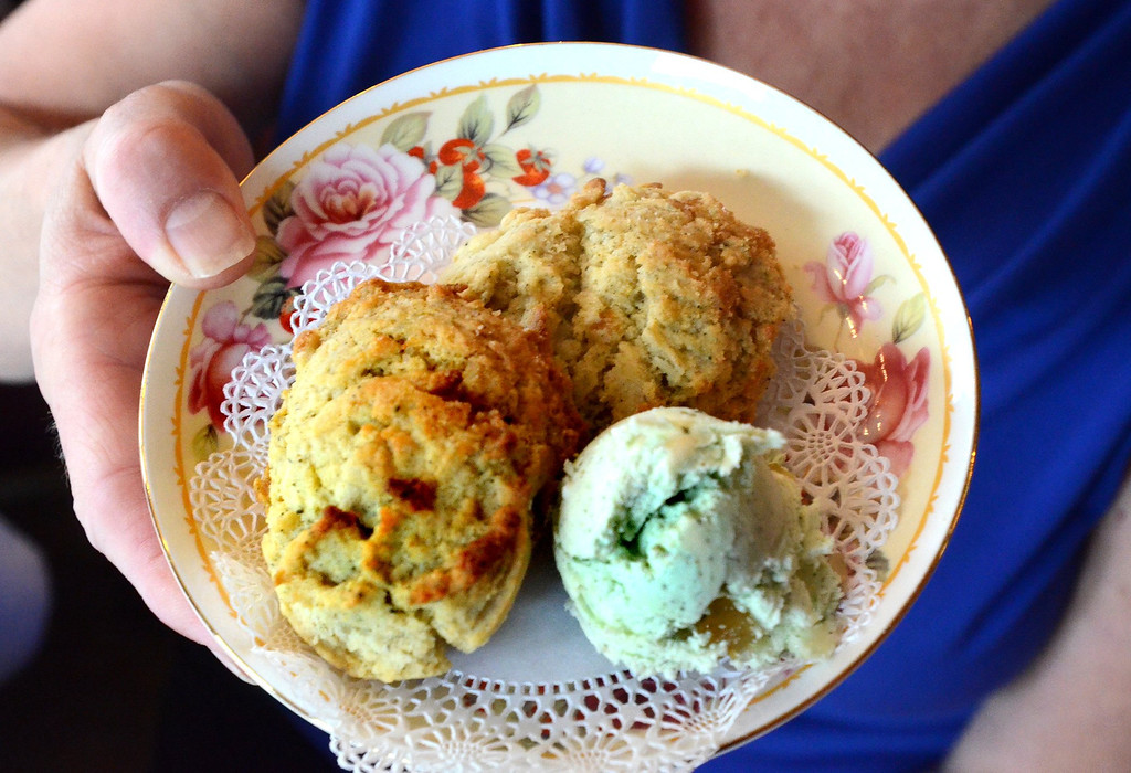 . ***WITH VIDEO***   Special scones made by Loretta Curry, owner of Victorian Rose Restaurant & Tea House in Rochester, for the arival of the new Royal baby. The scone is a Green Pear Tea.    Tuesday, July 23, 2013.  The Oakland Press/TIM THOMPSON