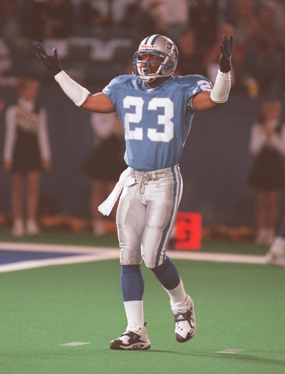 . Detroit Lions cornerback Terry Fair (#23) pumps up the crowd  in the first quarter, Thursday, October 15, 1998.