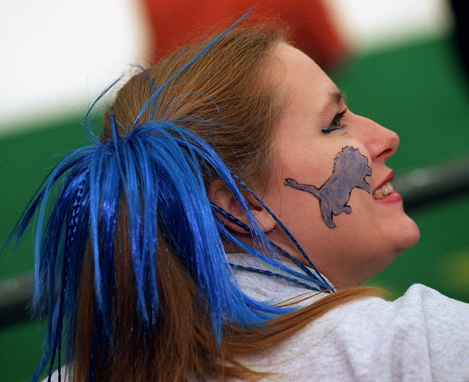 . Windsor\'s Niki Richardson painted a Lion on her face and added blue streamers to her hair for the Detroit Lions/ Green Bay Packers Thanksgiving Day game at the Pontiac Silverdome.