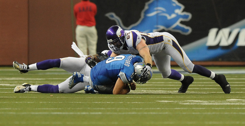 . Detroit Lions quarterback Matthew Stafford is sacked on the final play of the game by Minnesota Vikings defenders Jared Allen, top, and Everson Griffen.  The Vikings beat the Lions 20-13.  Photo taken on Sunday, September 30, 2012, at Ford Field in Detroit, Mich.  (Special to The Oakland Press/Jose Juarez)