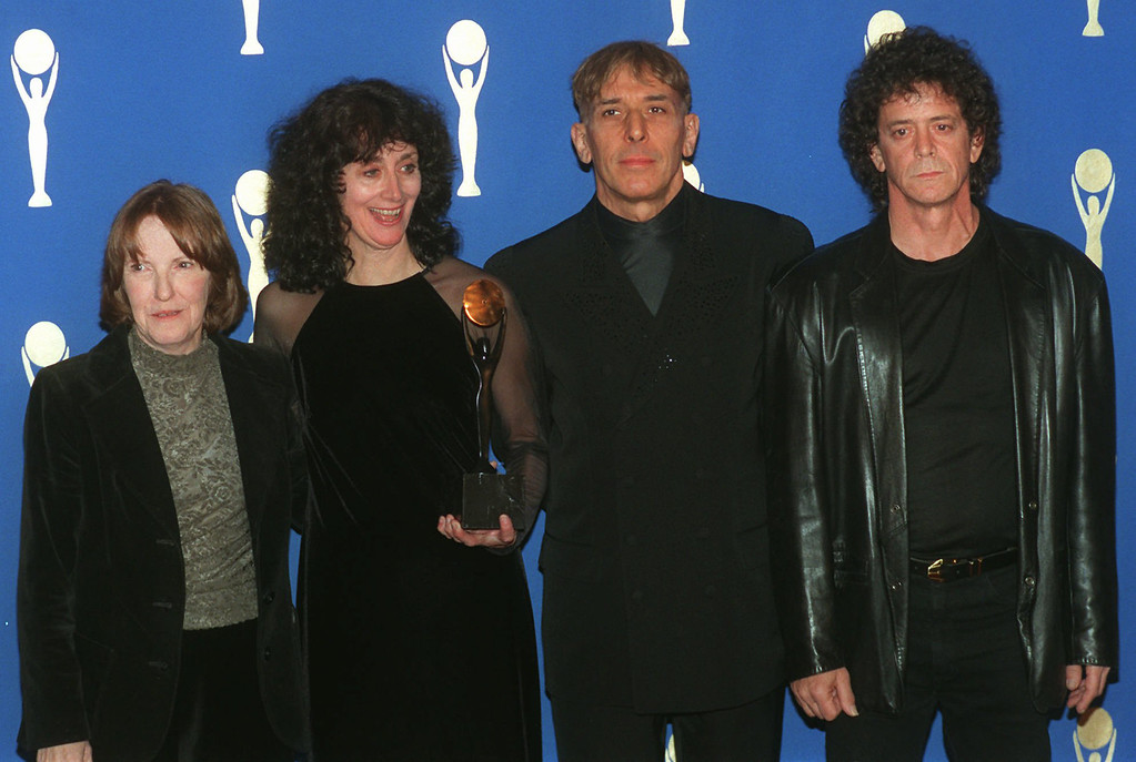 . FILE - In a Wednesday, Jan. 17, 1996 file photo, members of the band the Velvet Underground, from left, Maureen Tucker; Martha Morrison, attending for her late husband, Sterling Morrison; John Cale and Lou Reed pose backstage after their induction into the  Rock and Roll Hall of Fame in New York s Waldorf-Astoria Hotel. Punk-poet, rock legend Lou Reed is dead of a liver-related ailment, his literary agen said Sunday, Oct. 27, 2013. He was 71. (AP Photo/Joe Tabacca, File)