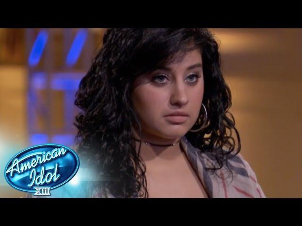". Jene Irene of Farmington Hills waits for judges to tell her if she was going home or moving into the Top 30 on ""American Idol.\"" Photo courtesy of Fox"