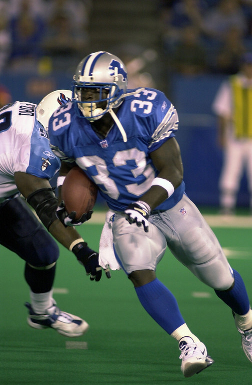 . Detroit Lions  Running Back Sedrick Irvin (right) eludes Tennessee Titan defender Henry Ford during the first half of the Lions preseason game at the Silverdome Thursday night.