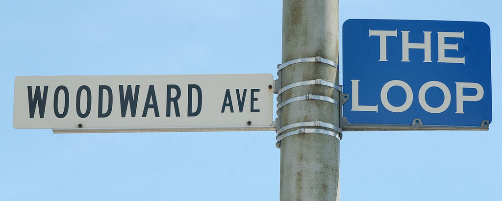 . The Woodward Avenue and Loop signs, perched atop a pole near the intersection of Saginaw and Woodward.  Photo taken during the annual Dream Cruise, Saturday, August 16, 2008, in Pontiac, Mich.  (The Oakland Press/Jose Juarez)