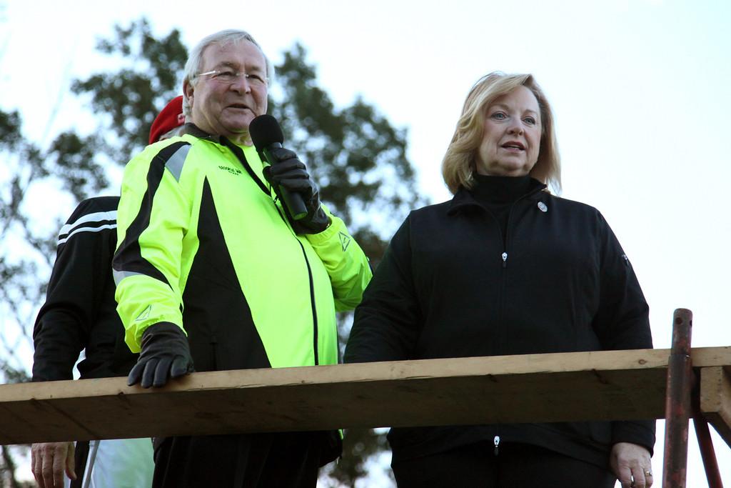 . Oakland County executive L. Brooks Patterson and Laraine Yapo, the VP of sponsor HealthPlus Michigan, speak during the festivities surrounding the 2010 Brooksie Way half marathon on Sunday, Oct. 3, 2010.