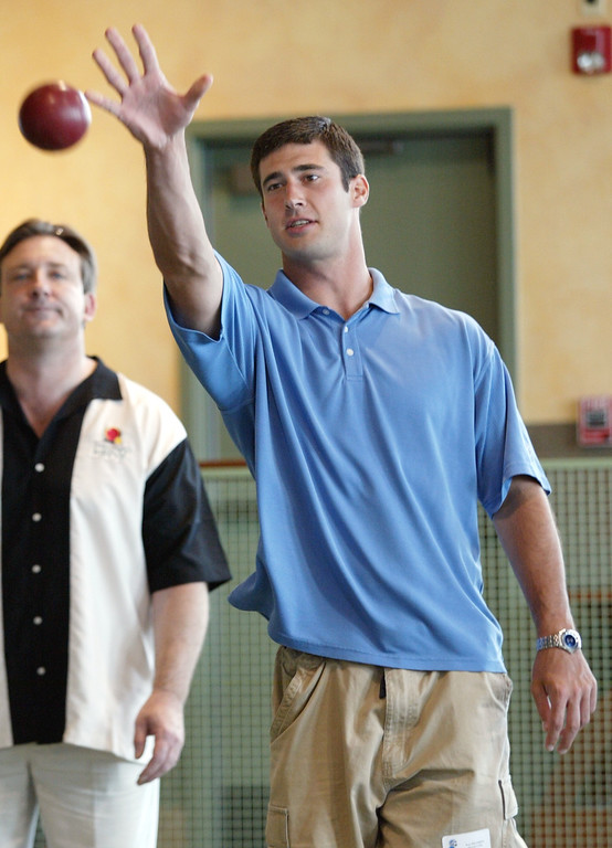 . Lions quarterback Joey Harrington tosses a practice ball during the Steve Mariucci Bocce Ball Tournament held at Palazzo di Bocce in Auburn Hills. Photographed Wednesday, June 9, 2004.