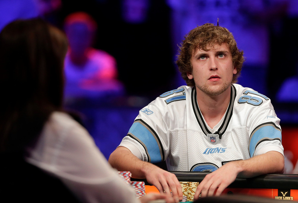 . Ryan Riess checks the scoreboard in the final hand against Jay Farber during the World Series of Poker Final Table, Tuesday, Nov. 5, 2013, in Las Vegas. Riess defeated Farber for the $8.4 million payout. (AP Photo/Julie Jacobson)