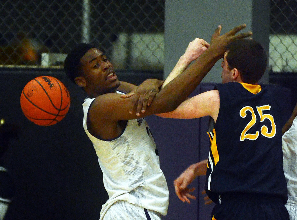 . Bloomfield Hills #11 Yante Maten and Clarkston\'s #25 Michael Nicholson battle for a rebound during their game at Bloomfield Hills High School, Tuesday January 28, 2014. (Vaughn Gurganian-The Oakland Press)