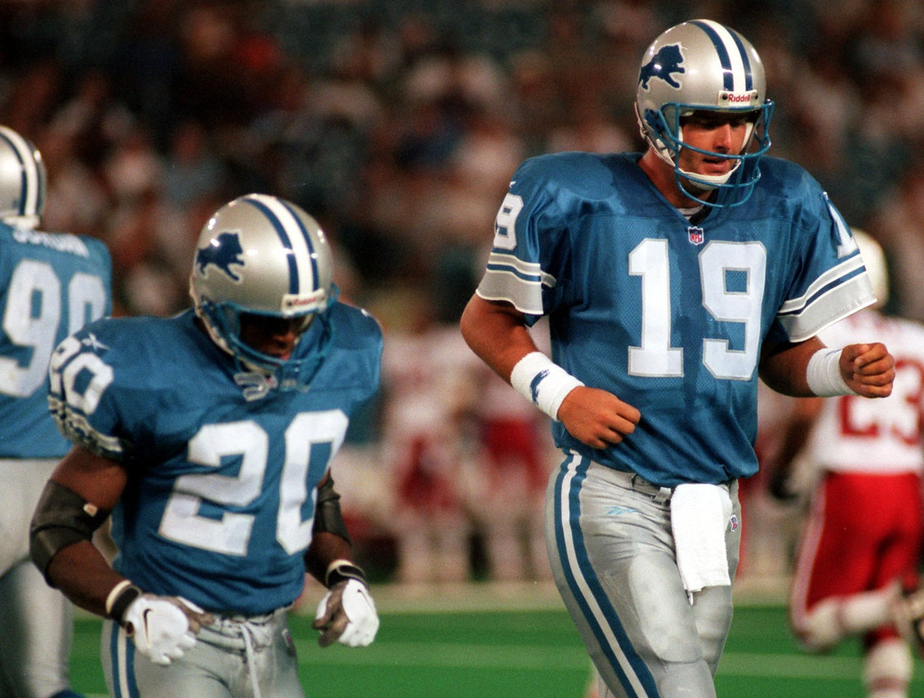 . Detroit Lions Barry Sanders (20) and Scott Mitchell run off the field during the first quarter of the preseason home opener against the Arizona Cardinals.