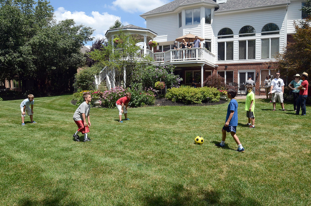 """. A soccer scene is rehearsed for the movie \""""Papou,\"""" being filmed on location at a home in Novi, Thursday July 25, 2013. (Oakland Press Photo:Vaughn Gurganian)"""