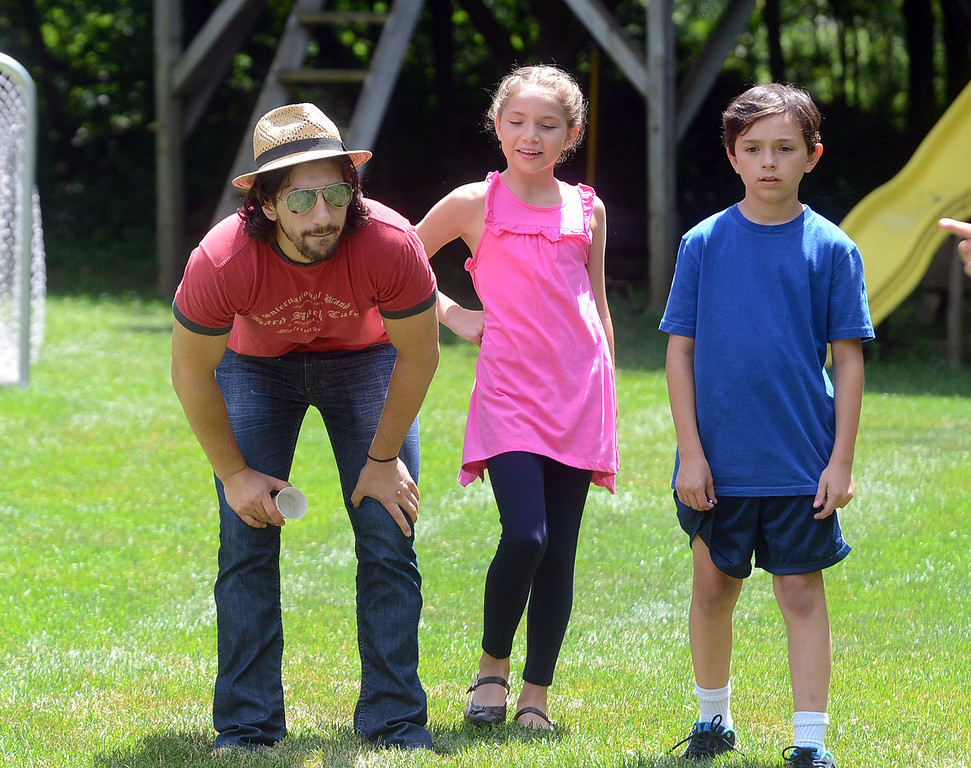 """. Director Michael Angelo Zervos (left) and Evan Kole (right), who is the young lead in the movie \""""Papou,\"""" check out a scene being filmed on location at a home in Novi, Thursday July 25, 2013. (Oakland Press Photo:Vaughn Gurganian)"""