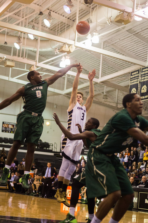 . Oakland\'s Travis Bader shoots a 3-pointer Tuesday, Oct. 29, 2013 at the Athletics Center O\'rena. Photo by Dylan Dulberg