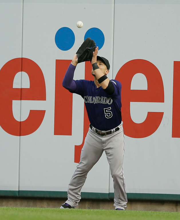 . Colorado Rockies right fielder Carlos Gonzalez catches the flyout hit by Detroit Tigers\' Nick Castellanos during the second inning of an interleague baseball game, Friday, Aug. 1, 2014, in Detroit. (AP Photo/Carlos Osorio)