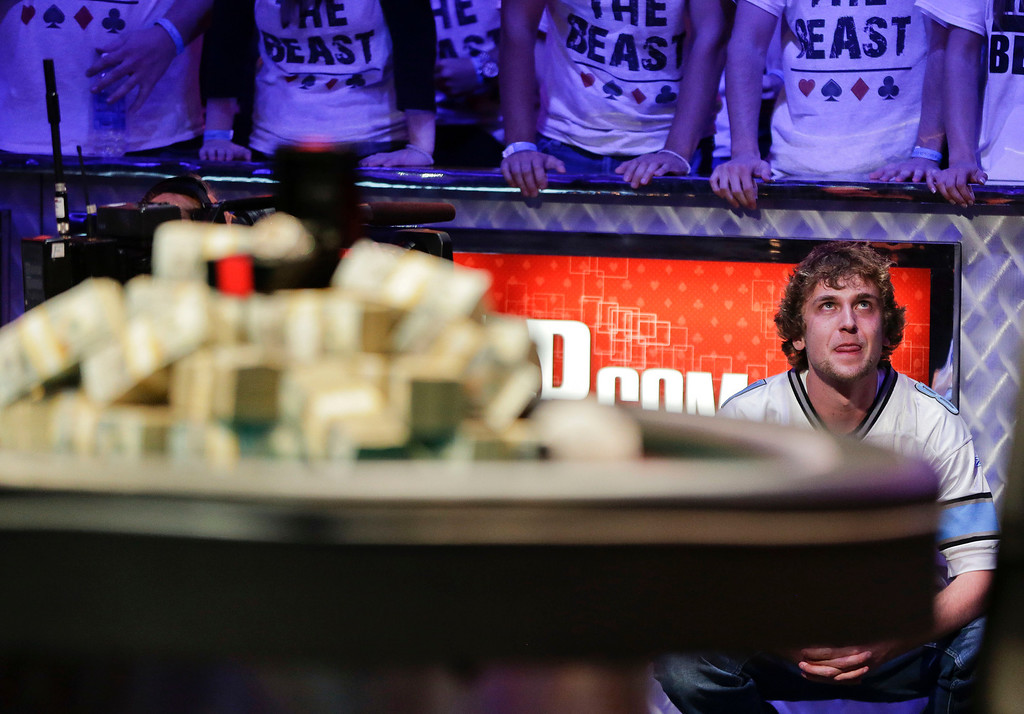 . Ryan Riess watches as the dealer draws the river card on what was the last hand of the World Series of Poker Final Table against Jay Farber, Tuesday, Nov. 5, 2013, in Las Vegas.  Riess won a first place payout of $8.4 million. (AP Photo/Julie Jacobson)