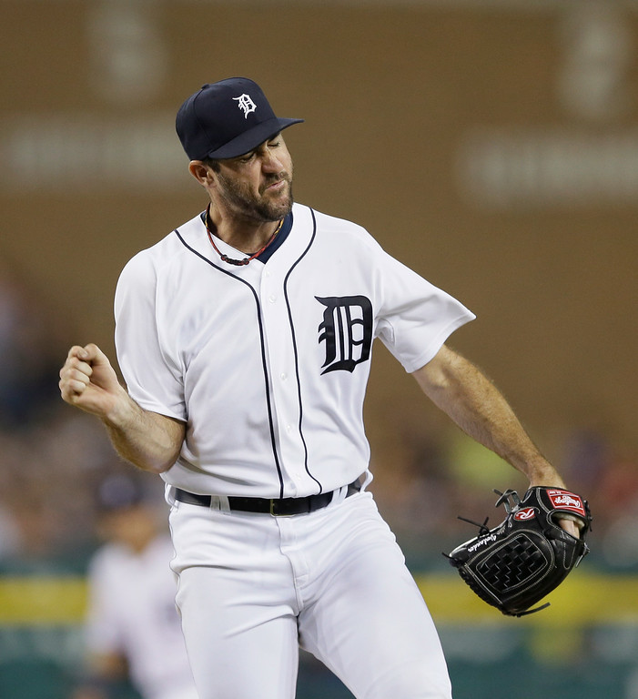 . Detroit Tigers starting pitcher Justin Verlander reacts after striking out Colorado Rockies\' Charlie Blackmon to end the top of the seventh inning of an interleague baseball game, Friday, Aug. 1, 2014, in Detroit. (AP Photo/Carlos Osorio)