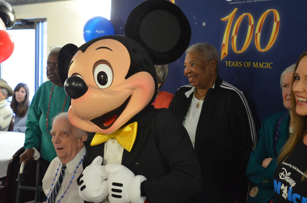 . Mickey Mouse reacts as kids sing birthday songs at the 85th birthday anniversary party organized by Disney On Ice at American House Senior Living Community in Southfield.