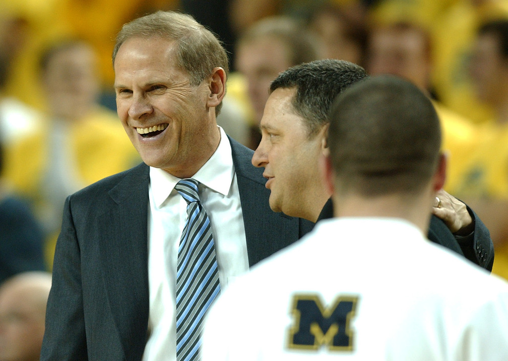 . OU men\'s basketball vs University of Michigan.  UM head coach John Beilein, far left, shares a laugh with Oakland head coach Greg Kampe before the start of their game.  Photo taken on December 12, 2007, in Ann Arbor, Mich.  (The Oakland Press/Jose Juarez)