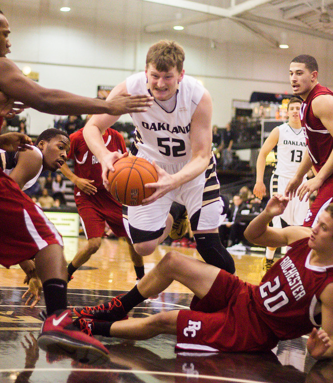 . #52 Joey Asbury attempts to push through a group of Rochester College players for a lay-up attempt. Photo by Dylan Dulberg