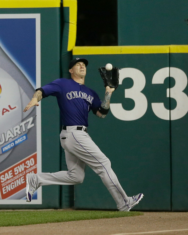 . Colorado Rockies right fielder Brandon Barnes catches a fly ball by Detroit Tigers\' Nick Castellanos during the sixth inning of an interleague baseball game, Friday, Aug. 1, 2014, in Detroit. (AP Photo/Carlos Osorio)