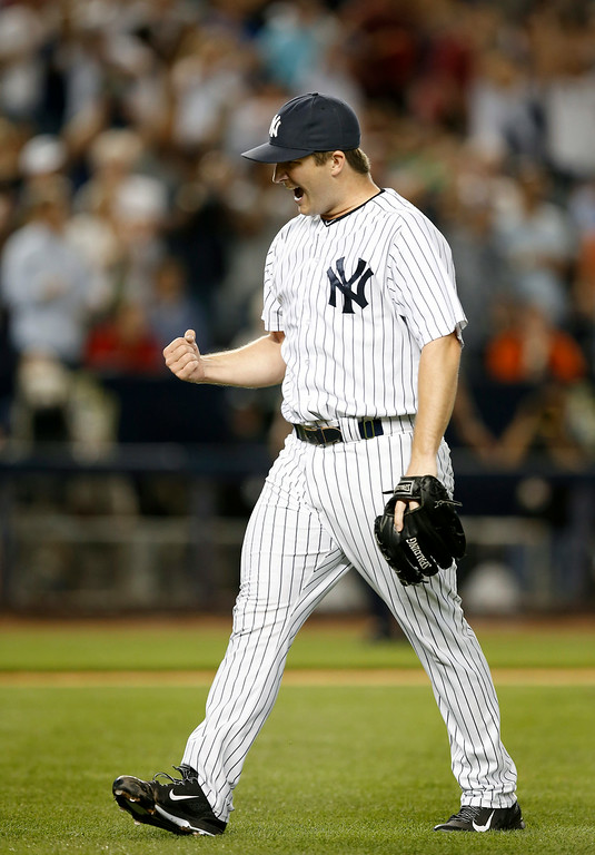 . New York Yankees relief pitcher Adam Warren (43) reacts after pitching out of a  seventh-inning jam in a baseball game against the Detroit Tigers at Yankee Stadium in New York, Wednesday, Aug. 6, 2014.  Warren was the winning pitcher in the Yankees 5-1 victory over the Tigers. (AP Photo/Kathy Willens)