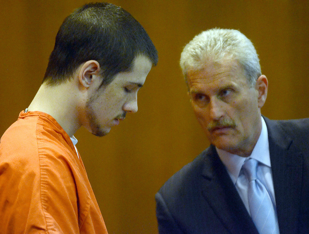 . Tucker Cipriano (left) speaks with his attorney Mitchell Ribitwer before being sentenced to life with no parole for the beating death of his father Robert, in the courtroom of Oakland County Circuit Court Judge Shalina Kumar,  Wednesday July 24, 2013. (Oakland Press Photo:Vaughn Gurganian)