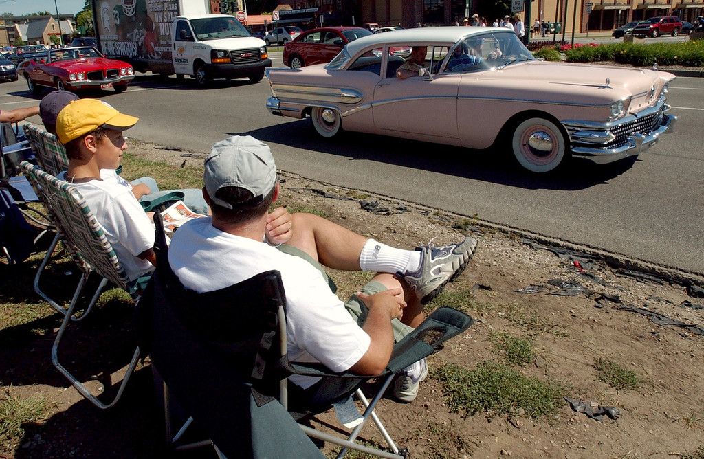 . Fans watch classic cars heading southbound on Woodward Avenue during the annual Dream Cruise.  Photo taken on Saturday, August 16, 2008, in Birmingham, Mich.  (The Oakland Press/Jose Juarez)