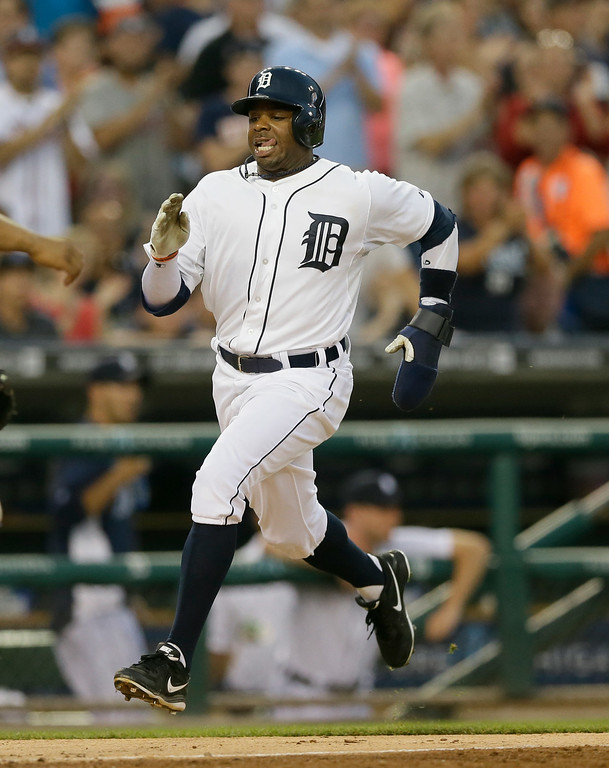 . Detroit Tigers\' Rajai Davis scores from first on a double by teammate Ian Kinsler during the fifth inning of an interleague baseball game against the Colorado Rockies, Friday, Aug. 1, 2014, in Detroit. (AP Photo/Carlos Osorio)