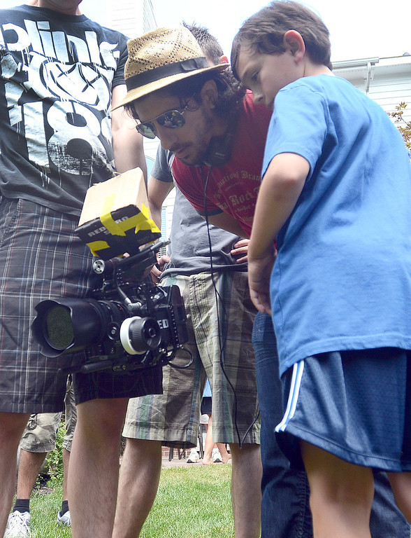 """. Director Michael Angelo Zervos (left) and Evan Kole, who is the young lead in the movie \""""Papou,\"""" look at a scene that was shot on location at a home in Novi, Thursday July 25, 2013. (Oakland Press Photo:Vaughn Gurganian)"""