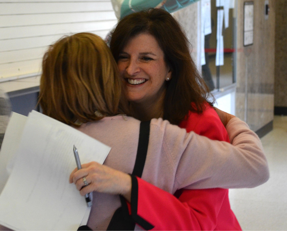 """. Oakland County Clerk Lisa Brown hugs Oakland County Commissioner Marcia Gershenson, a Bloomfield Hills Democrat, at the county courthouse Saturday morning. \""""Good morning! How\'s everyone doing today?\"""" Brown said to cheers from those waiting in line for a marriage license. Dustin Blitchok-The Oakland Press"""