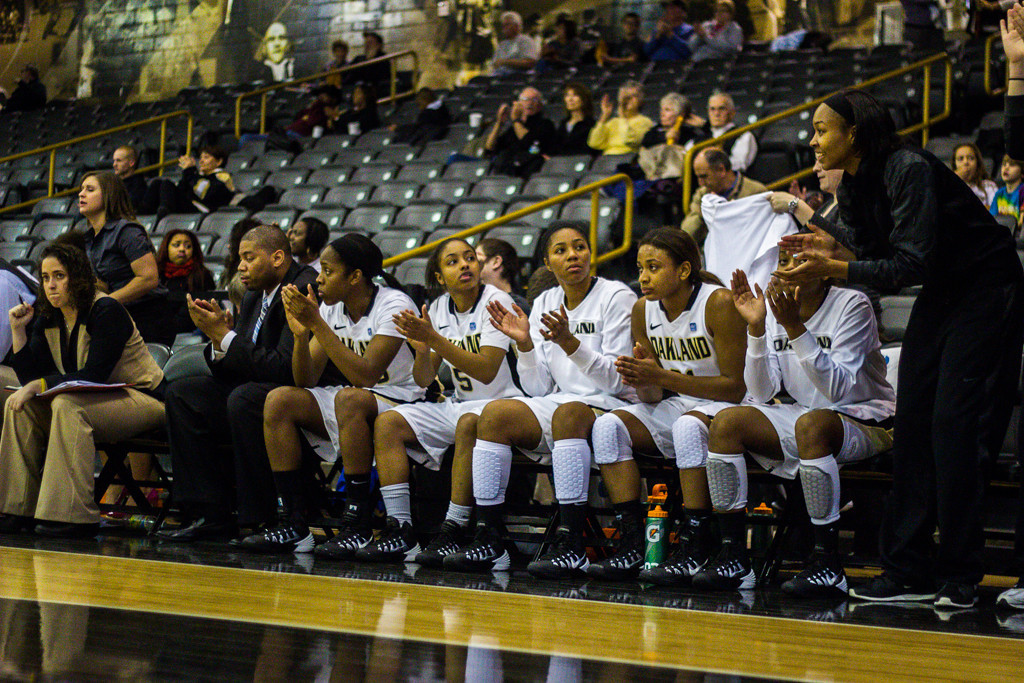 . The team celebrates a three-point shot in the second half. Photo by Dylan Dulberg