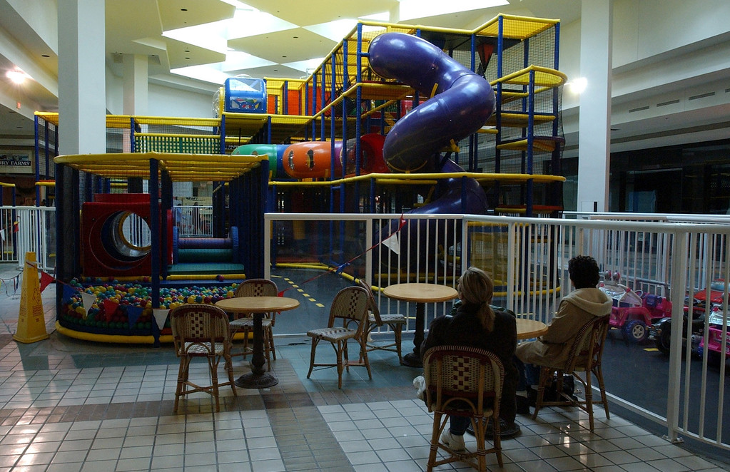 . Parents watch their children play at the new play area inside Summit Place Mall in Waterford Tuesday December 10, 2002.