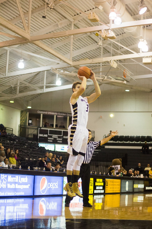 . Oakland guard Travis Bader attempts a 3-pointer at the start of the second half Tuesday, Oct. 29, 2013 at the Athletics Center O\'rena. Photo by Dylan Dulberg