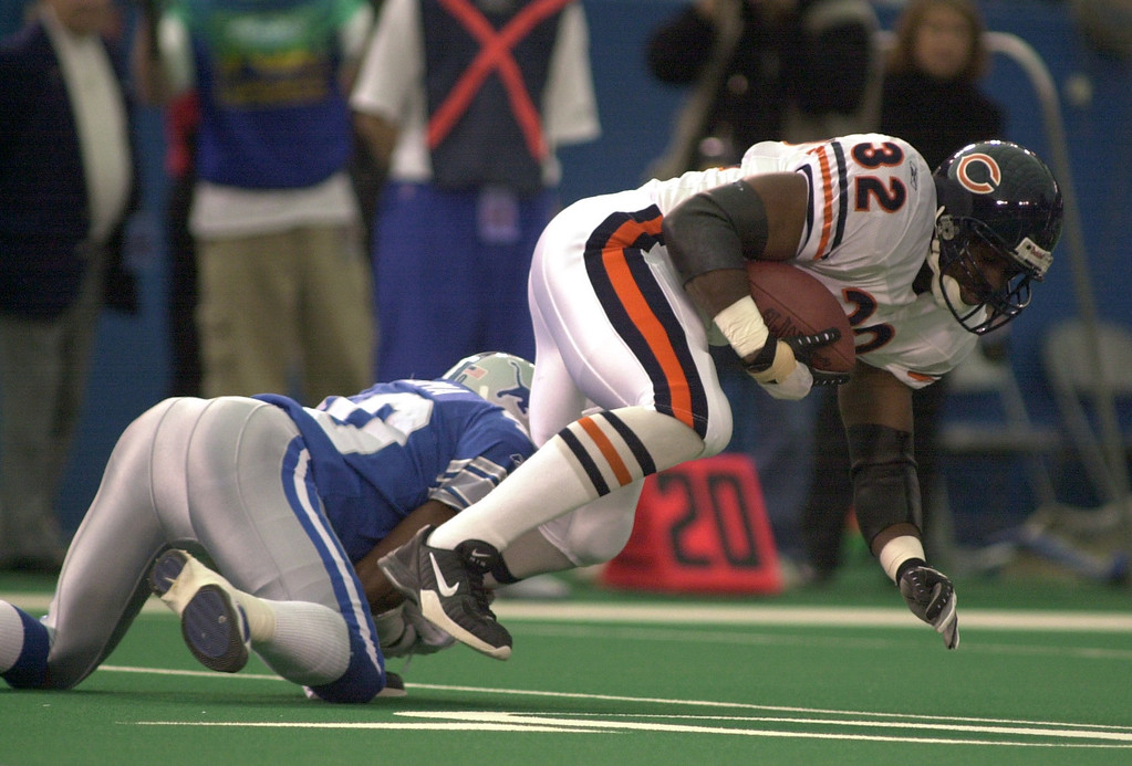 . Chidi Iwuoma (40) of the Detroit Lions brings down Leon Johnson (32) of Chicago bears in the first half of action during  Sunday\'s game played at the Pontiac Silverdome on Sunday Dec. 30, 2001. The Bears won 24-0 over the Lions.