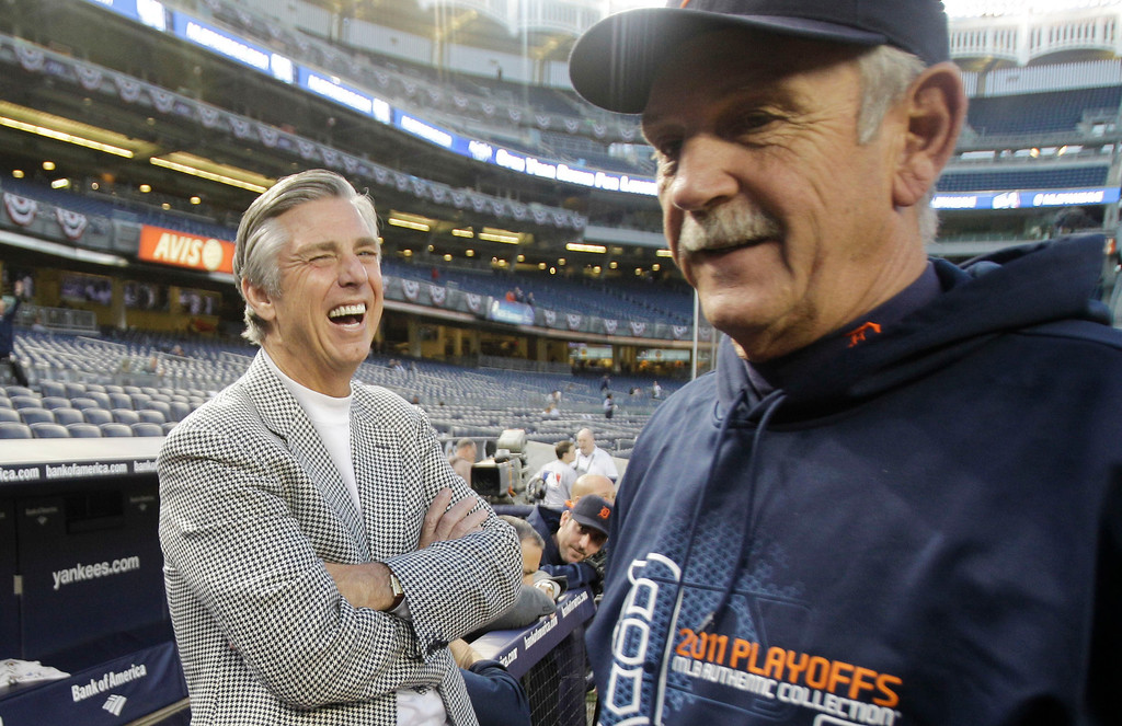 . FILE - In this Oct. 6, 2011 file photo, Detroit Tigers\' general manager Dave Dombrowski, left, laughs with manager Jim Leyland before Game 5 of baseball\'s American League Division Series in New York. After a season in which Detroit won its first division title since 1987, Dombrowski now must look to improve the roster of a team that has not won the World Series in almost three decades. (AP Photo/Kathy Willens, File)