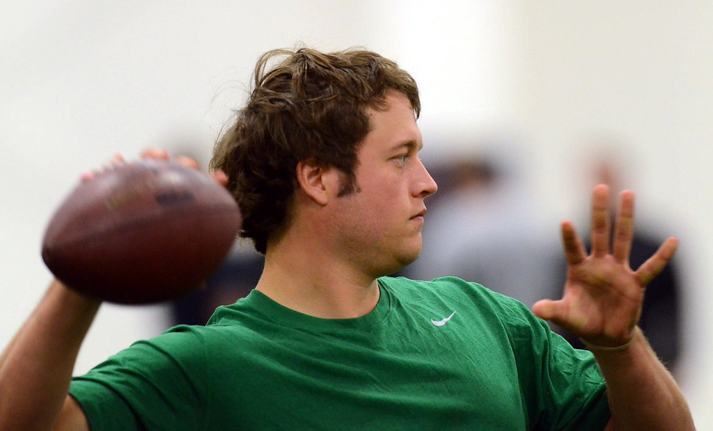 . Quarterback Matthew Stafford works out during the Detroit Lions informal practice at Detroit Country Day, Tuesday May 17,  2011. (Oakland Press Photo: Vaughn Gurganian.)