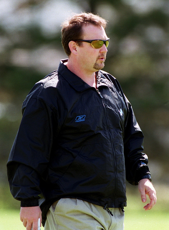 . Detroit Lions head coach Marty Mornhinweg watches his team practice during the Lions morning session of mini camp, Friday, April 27, 2001, at the Lions practice facility in Pontiac, Mich.